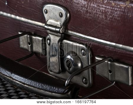 close-up fragment of locks and fasteners on the vintage leather suitcase poster