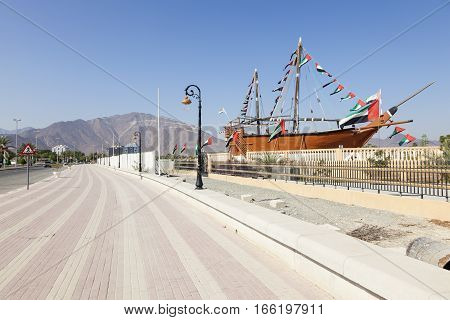 Historic dhow ship at the corniche in Khorfakkan United Arab Emirates