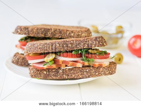 Freshly Made Ham Sandwich On A White Wooden Table.