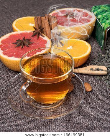 Hot green tea with fresh citrus fruits