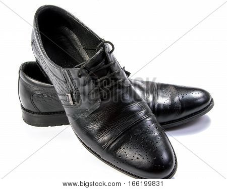 Male black shoes isolated on white .