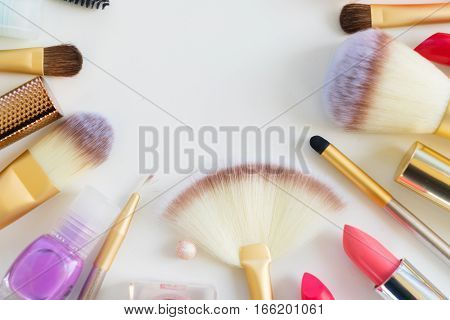 Colorful make up and brushes flat lay scene close up