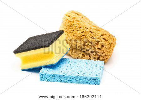 Assorted collection of plastic and natural cleaning sponges over white background