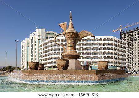 FUJAIRAH UAE - DEC 1 2016: Arabian coffeepot fountain monument in the city of Fujairah United Arab Emirates