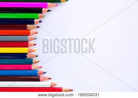 White Background For Presentation With Vertical Round Multicolored Pencil Border