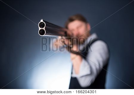 Manager Holding A Shotgun