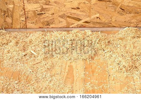 Lot of sawdust and shavings on constructed new house floor closeup