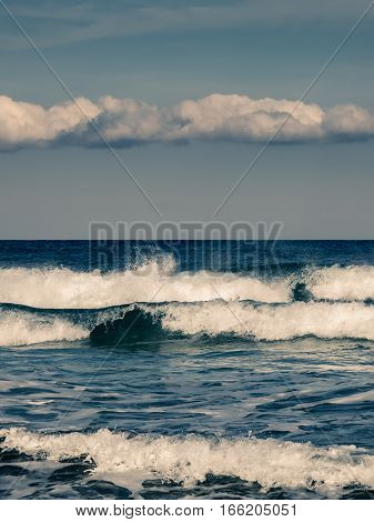 Waves Crashing Onto Beach In Corsica