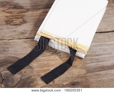 White Fireblanket on a brown wooden background