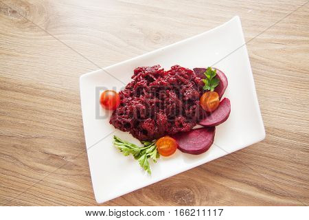 preserved beet on plate with tomato and parsley