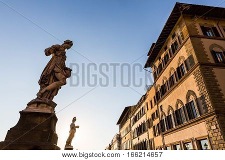 A Statue At The Ponte Santa Trinita Bridge In Florence, Italy