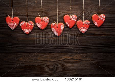 Line Of Red Gingerbreads Hearts On Ribbon.