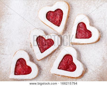 Cookie on the valentine's day. Lovely heart shaped linzer cookies with strawberry jam a shortcake dough for valentines. Homemade baking. Flat lay. Top view.