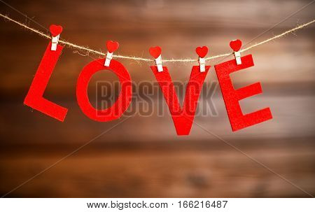 background Valentine's day. two red hearts and the word Love on the wooden background