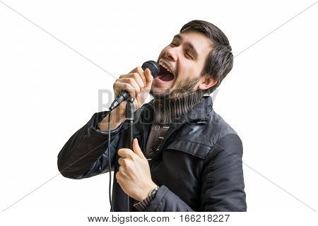 Karaoke Concept. Young Man Holds Microphone And Singing Song. Is