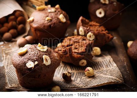 nutella and hazelnuts  cakes.rustic style. selective focus.