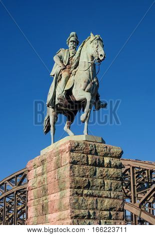 Cologne, Germany - January 19, 2017: Equestrian statue of Prussian King Wilhelm I. Friedrich Ludwig. Located at the Hohenzollern Bridge.