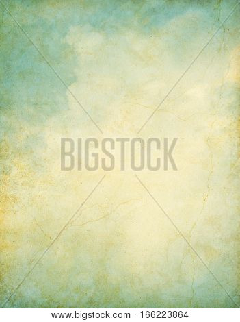Clouds on a vintage grunge background. Image displays a pleasing paper grain and texture at 100 percent.