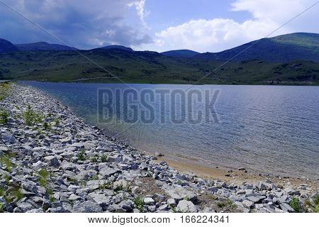 Famous Lake Belmeken in Rila mountainBulgaria. It is the highest dam lake on the Balkan peninsula.