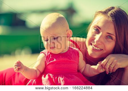 Woman and child posing in summeral clothing on sunny day