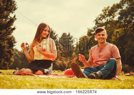 Love romance relationship dating concept. Enamoured couple in park. Girl and boy in park on picnic.