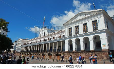 Quito, Pichincha / Ecuador - January 22 2016: People walking in front of the Carondelet Palace. This palace is the seat of the presidency of the republic