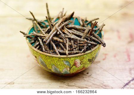 Wellness Tea drink, Bitter Twisted Leaves of Ilex Kudingcha. Green tea Kuding