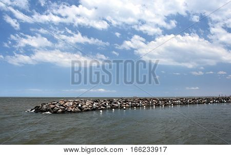 Rock pier at St Kilda. Dam rock on beach for protecting the sea erosion.
