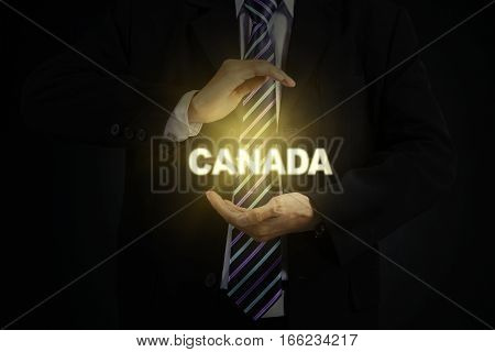 Close up of male entrepreneur wearing formal suit and protecting a word of Canada