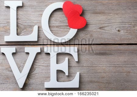 Love and still life concept. Valentines day holiday letters text message card with red hearts. Top view flat lay overhead, copy space background