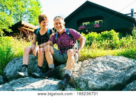 Active senior couple having fun outdoors, enjoying the good weather.