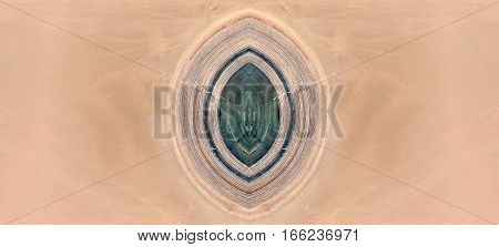 The vulva of the desert, symmetrical photographs of landscapes of the deserts of Africa from the air,