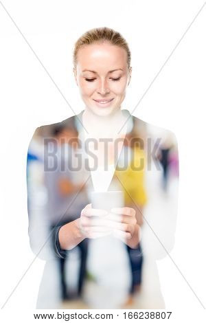 Beautiful young caucasian woman in business attire using smart phone application on white background. Double exposure with abstract blur of couple dating in background.