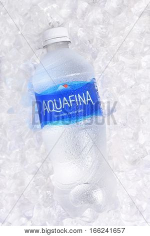 IRVINE CALIFORNIA - JANUARY 22 2017: Aquafina Water Bottle on ice. The purified water brand is produced by PepsiCo in both flavored and unflavored varieties.
