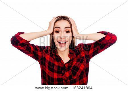 Portrait Of Happy Shocked Brunette Touching Her Head