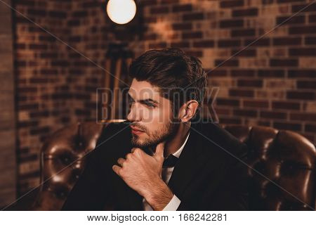 Young Ponder Businessman In Tuxedo Thinking About Smth