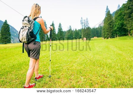 adult woman hiking by the vilsalpsee in austria