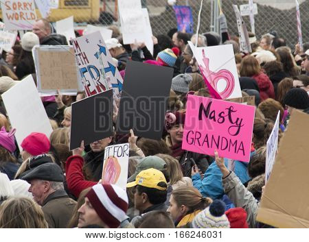 PHILADELPHIA, PA - JAN 21 2017: Women's March on Philadelphia. A sister march of Women's March on Washington. Women and men gathering in peaceful protest on Benjamin Franklin Parkway. Nasty Grandma sign.