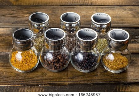 powder spices in glass bottle on a white background