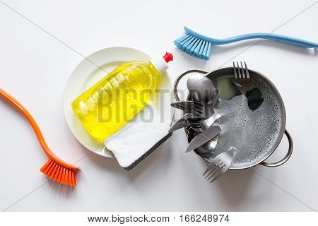 concept of washing dishes on white background top view.
