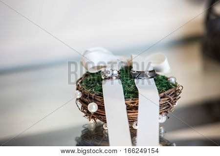 Wedding ring bands on a rustic ring holder
