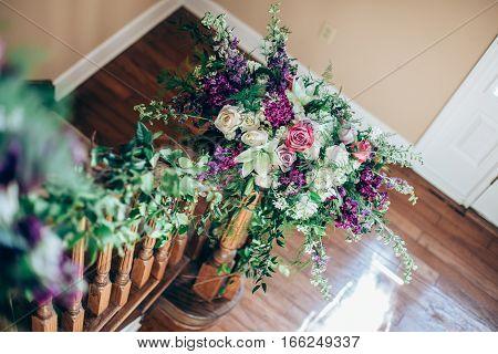Purple and white Wedding flower arrangement indoors