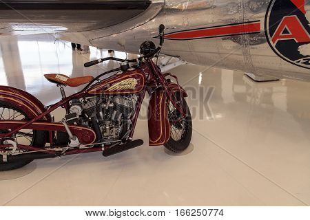 Santa Ana CA USA - January 21 2017: Red Indian motorcycle displayed at the Lyon Air Museum in Santa Ana California United States. It was used during World War II. Editorial use only.