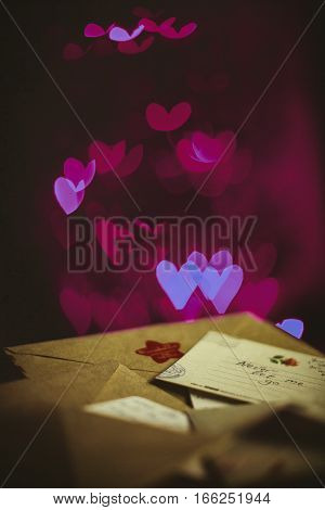 Valentines day letters cards glowing purple hearts in the dark