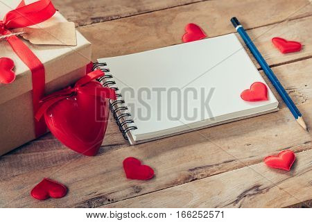 Blank Notebook And Gift Box With Red Heart On Wood Background.