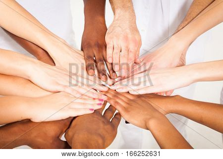 Studio shot of multi-ethnic young adults' hands
