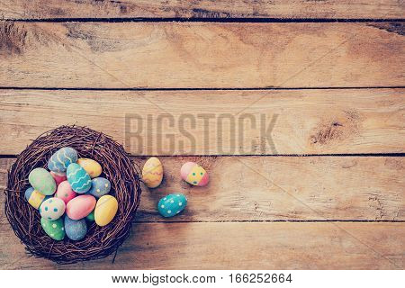 Colorful Easter Egg In The Nest On Wood Background With Space
