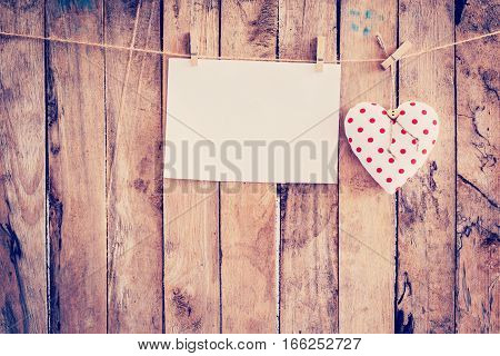 Heart Fabric And Paper Hanging On Clothesline At Wood Background With Space.