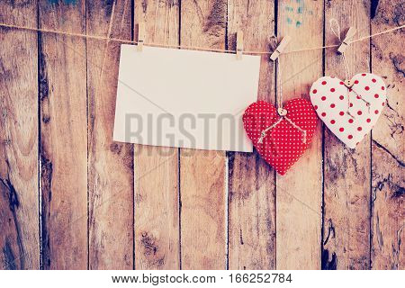 Two Heart Fabric And Paper Hanging On Clothesline At Wood Background With Space.