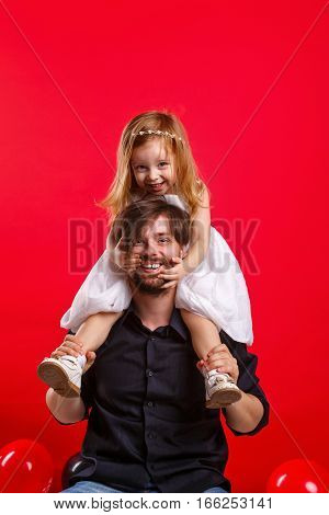 Father and daughter piggyback. Emotional games with your child. Family fun. The joy of communication. Parental support.